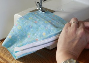 Sew the first side seam, lining up edges