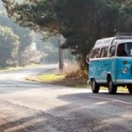 Turquoise VW camper van on the road in the Isle of Wight