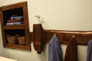 The towel hook-rack has a 'live' edge